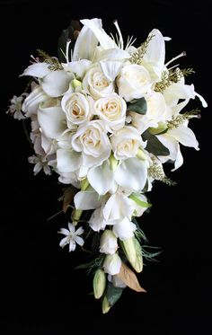 Louisa....silk Bridal bouquet.  A true elegant bridal bouquet. Features real touch Casablanca lilies, real touch calla lilies, ivory roses, lily buds, mini lilies, magnolia leaf and fern sprigs. Contact Maria for details on 0439 810 982