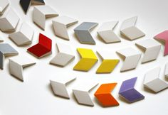 Slip-cast earthenware tiles by industrial designer Kristina Gerig. They tessellate in three different ways...