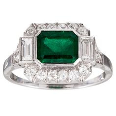 Art Deco 1.50 Carat Emerald Diamond Platinum Ring | From a unique collection of vintage cluster rings at https://www.1stdibs.com/jewelry/rings/cluster-rings/