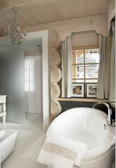 Winter white painted log cabin bathroom