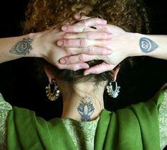 """On both of Lisa Mitchell's wrists: Sanskrit symbol for """"Prem,"""" or Love"""
