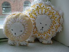 Custom made lion pillows, utilizing vintage crochet doilies.