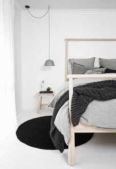 Exchange a normal bedside lamp for two hanging pendants either side of your bed. Contemporary or what!?