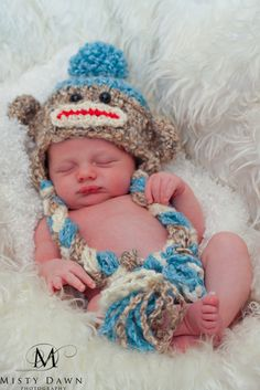 For leslie's new baby. Sock Monkey Hat - Hand Crochet Unisex Baby or Toddler Beanie - Super Soft with Pom Pom in Oatmeal, Blue and Cream. $32.99, via Etsy.