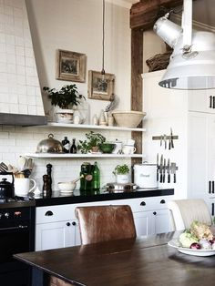 Black/White scheme with leather, exposed wood, collectibles on shelves