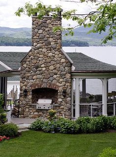 Grill tucked in stone chimney outside of screened porch :: Lake View