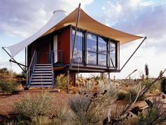 The tents at Longitude 131 in Australia come with private showers, mini bars, and housekeeping