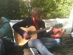 Damien playing Woody Guthrie, Roll on Columbia at Climate Rush's recent clean air parade on International World Car Free Day.