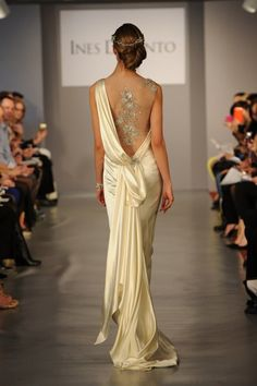 The Back Story  So you love the cut-out trend that's all the rage in ready-to-wear? Then this Grecian-inspired Ines Di Santo gown has a seriously deep dip and bedazzled see-through insert for a faux-nude look.