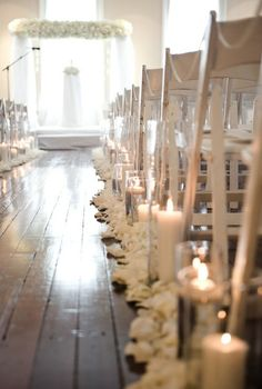 aisle with candles & petals. love the white chairs.