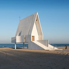 Vector Architects has built a concrete chapel on a Chinese beach, but raised it up above the sands so that seawater can wash underneath