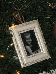 grab these mini frames from dollar tree, spray paint and add ribbon (hot glue gun), then give as little holiday favors- perfect with a child's photo or your own printed sentient