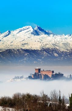 Gabiano castle over the fog in background the Alps