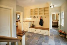 Spacious Mudroom with Built-In Cabinets - traditional - entry - minneapolis - Ron Brenner Architects I like the idea of a charger station near the mud room. Just need a way to fit in a key shelf Cape Cod Bathroom, Entry Way Design, Slate Flooring, Slate Tiles, Flooring Options, Built In Cabinets, Mudroom Cabinets, Upper Cabinets, Elegant Homes
