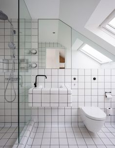 When embarked on a London house extension, the firm finished an ensuite bathroom in white tiles that cover almost every surface, including the sink. 📸 by Salt Productions. Loft Bathroom, White Bathroom Tiles, Bedroom Loft, White Tiles Black Grout, Loft Room, Bathroom Layout, Bad Inspiration, Bathroom Inspiration, White Square Tiles