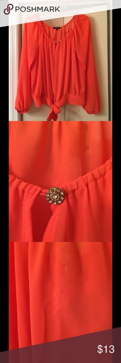 XOXO orange blouse with cute details XOXO blouse- rhinestone button, drawstring tie at waist, elastic at cuffs.  Only flaw I could find is slight thread pull in center of back.  See pic #4. XOXO Tops Blouses
