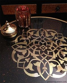 Stencil Painted on Glass Table Top tutorial for glass top for living room hexagon storage