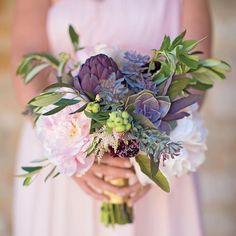 Another gorgeous wedding bouquet that steal our hearts. Swap out flowers in your bouquet for unexpected elements, like artichokes, kale, cabbage and berries. Opt for vegetables in a similar palette for a cohesive look. Who agrees? Tag someone who would love this! Photography by Annie Mcelwain via theknot.com
