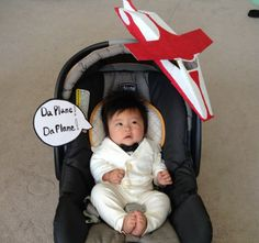 """TATTOO: As a child of the 1970s/1980s, I'm loving all the TV and movie references from that era this year. Dan from SF writes: I went old school with this costume. %0AHere is my 4 month old daughter, Ami Miki Lee, dressed as Tattoo from """"Fantasy Island."""" I took a plain white onesie and hand-sewed on extra fabric that I fashioned %0Ainto a coat and pants, to make it look like a mini-suit. I made an airplane and """"thought-bubble"""" sign out of cardboard & paint, %0Aand taped it to the stroller…"""