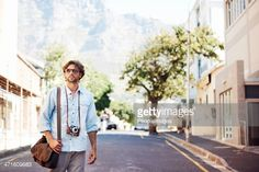 Casual male walking through the streets of an urban area with a satchel and his camera - Copyspacehttp://195.154.178.81/DATA/i_collage/pi/shoots/780936.jpg