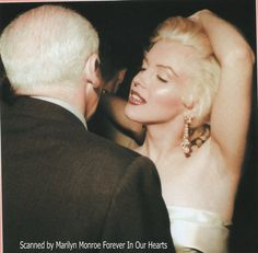 Rare color photo of Marilyn Monroe and Walter Winchell taken at his birthday party in 1953