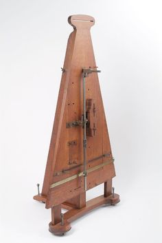 Photograph of a wooden instrument used for experiments on a pendulum moved by a spring