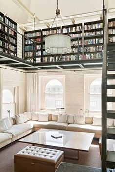 Contemporary Library with Bosworth tufted leather storage ottoman - espresso, Arched window, Loft, Exposed beam, Carpet