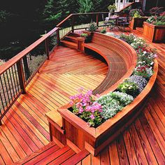 Built in, curved bench to enjoy the view. Love this deck..miss our wrap around deck back home :(