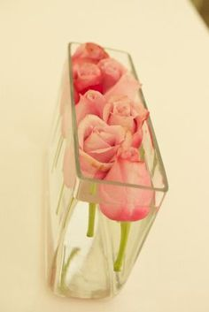 Pink Kenyan roses in a simple arrangement in water. Wedding floristry www.potters-blossom.com