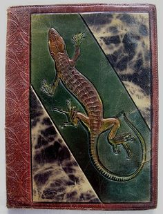 Art Deco book cover with salamander, tooled leather. Italian leather tooling art during the Art Deco period in Italy. ca. 1910