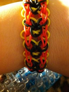 MICKEY MOUSE bracelet based on Awareness bracelet by Luella Clark. See video tutorial at https://www.youtube.com/watch?v=OWNjKilAVAs or on my Tutorial Board. **Pattern Change for Mickey version -  white on sides to red, pink to black and white cross bands to yellow.**  See helpful tips in Facebook comments - https://www.facebook.com/pages/Rainbow-Loom/340822649338519.