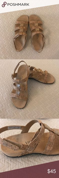 Vionic sandals size 7 Velcro closure Tan vionic ortho heel sandals size 7. 3 Velcro adjustable closures for the perfect fit. Worn twice and in excellent condition. Cork like straps with head detail. Great neutral color that goes with anything. Perfect for women with arch problems. Vionic Shoes Sandals