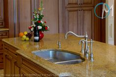 Madura Gold is the granite of choice on this island, which features a double bowl sink and dual faucets.