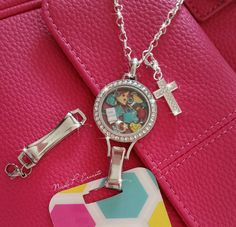 Check out this lanyard locket with our new safety break away clasp!! www.charmingsusie.origamiowl.com