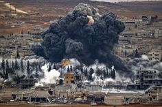 Smoke rises from the Syrian city of Kobani following an air strike by the US-led coalition. Kobani, also known as Ayn Arab, has been under assault by Islamic State extremists since September