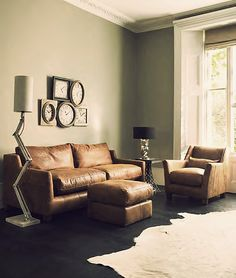 Holy Comfy Couch...Want this! Pass on the clocks though...