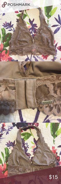 NWT VS Pink Lace Halter Bralette New with tags lace halter bralette in a neutral taupe. Lined, size medium. Has regular bra hooks on straps. PINK Victoria's Secret Intimates & Sleepwear Bras