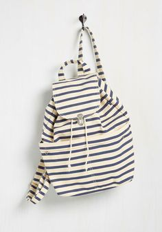 You've heard the gossip and have come to confirm - this backpack really is a canvas carry-all that goes the distance! From the classroom to the cruise ship, this navy-striped bag touts dual front pockets and an ocean of style for the trendsetting 'n' traveling thalassophile!