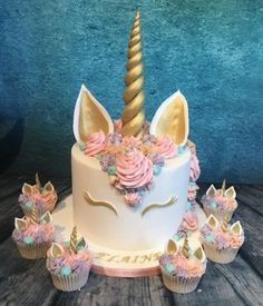 Beautiful pastels and gold unicorn cake and cupcakes