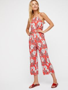 Fresh Fields Pleated Jumpsuit | Floral printed pleated jumpsuit featured in a wide leg silhouette.    * Ruffle strap detailing   * Elastic waistband   * Open surplice back   * Hip pockets