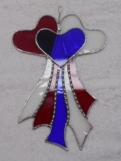Stained Glass Red, White and Blue Hearts and Ribbons Suncatcher measuring 10 x 5.5 inches. Built in the Foil and Solder method.    This