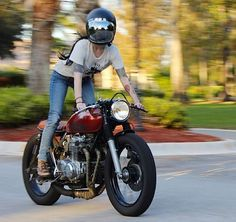 Not just posing with a bike, riding the bike. Fucking sexy. Girl on a cafe racer.