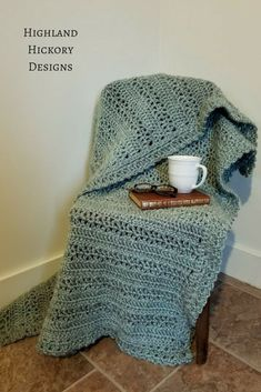 Crochet the Fireside Throw with this beginner friendly free pattern that is featured as part of Sewrella's Designer Program! This blanket uses on easy stitches and is perfect for sitting by the fire under the stars or in a cozy chair reading a book. #crochet #freecrochetpattern #afghan #crochetblanket #crochetthrow