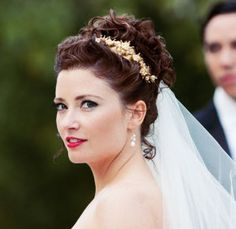 Curly up-do wedding hairstyle with tiara. Very formal and polished looking. Can't go wrong with an elegant classic look like this one.