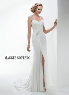 Graceful and elegant, this lightweight chiffon sheath wedding dress glitters with Swarovski crystal adorned sleeves and beaded motif at the waist. Featuring a keyhole back and dramatic front slit.
