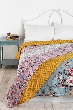 Plum & Bow Blossom Patchwork Quilt #urbanoutfitters  -  love the style, wouldn't be too hard to make one!