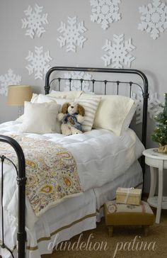 Sweet little girls bedroom decorated for winter. Foam snowflake accent wall is used to create a subtle Frozen theme for the season. Sleeps 'til Christmas Walk - Dandelion Patina http://www.dandelionpatina.com