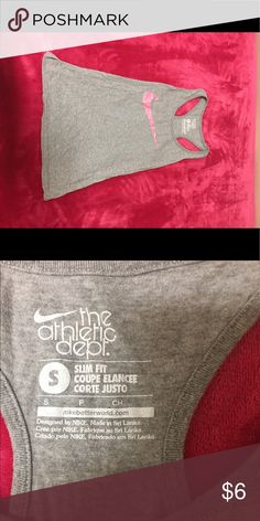 Nike tank top Worn a few times, like new. Grey tank top in great condition. Fitted. No flaws/smoke free home. Would fit small/xs. Nike Tops Tank Tops