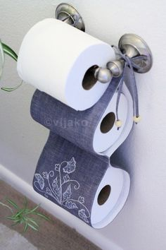 Fabric holder for extra TP rolls.