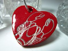 My hubby bought this for my birthday - I love it! Red Heart Lobster Pendant Necklace by PohdDesign on Etsy, $17.00